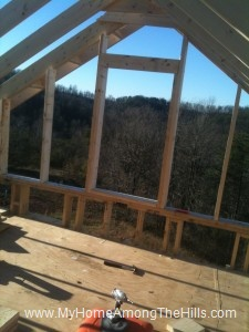 Big window framed into the gable of our small cabin