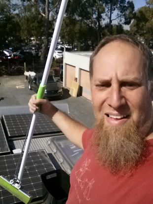 Jay with a mop and solar panels