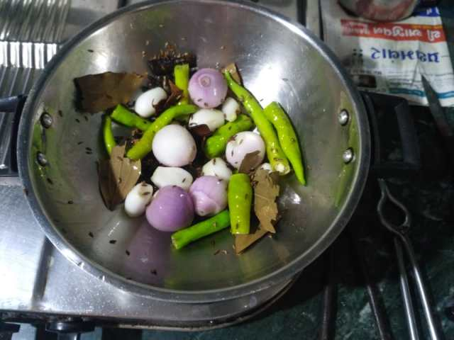 5. Add Onions and Green Chillies