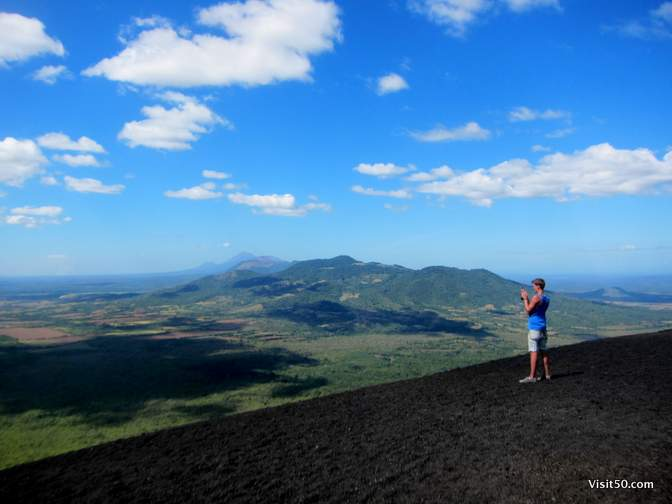 this pic almost doesn't look real. He's standing at the edge of the top of the volcano