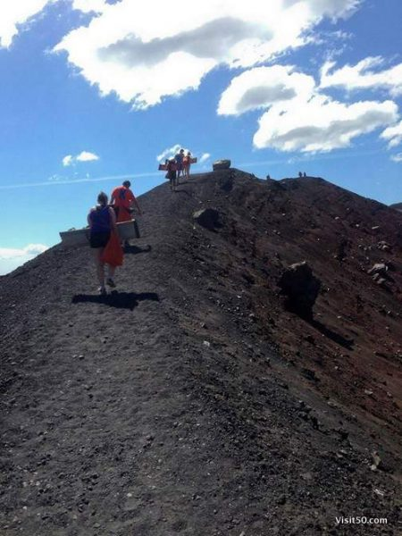 Climbing up a volcano full of lava rocks carrying plywood sleds and prison suits? check.