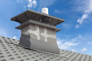 New gray metal tile roof with chimney