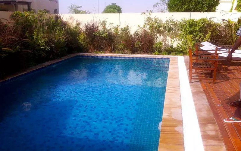 swimming pool with wooden decking system