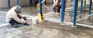 mapei-adesilex-p9-filler-application-prior-to-epoxy-floor-coating-in-Dubai