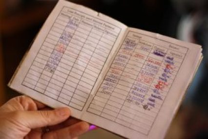 Each woman gets a savings passbook to record their progress