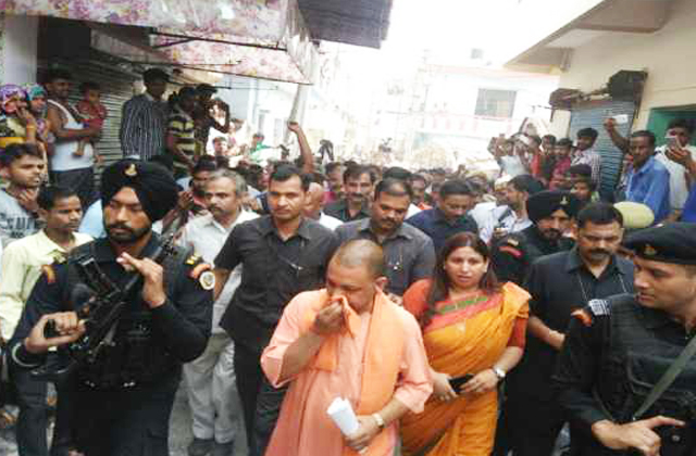 cm yogi keeps kerchief on his nose during his visit to allahabad
