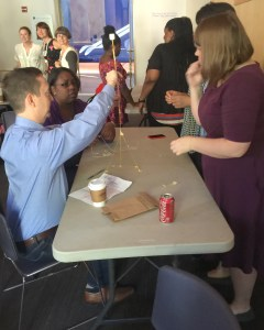 Alliance staff explore the marshmallow challenge in a team building exercise at the National Building Museum.