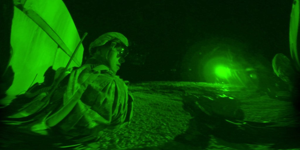 Night vision as soldiers raid a town