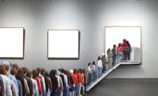 People line up to enter into a solid white image. other solid white images also line the walls