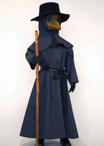 A mannequin dressed from head to toe in a long trench coat with a collared hood, plaque mask and black large rimmed hat holding a wooden stick.