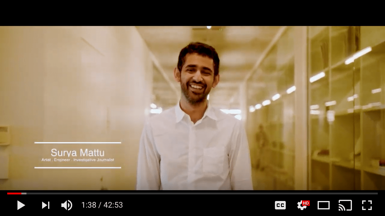 A man, Surya Mattu, smiles at the camera during the introduction to the video.