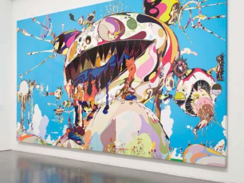 A fantastical landscape features a giant, multi-colored homunculus sitting on top of a hill, its open mouth revealing jagged teeth and seeping fluids, while pustules explode from other parts of its ovoid head.
