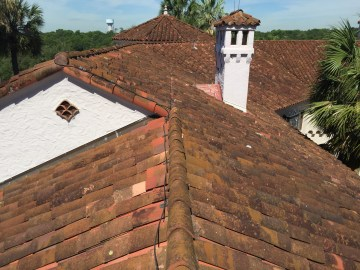 Close-up of the red curved Spanish tile on the roof of one of the McNay Museum's buildings.