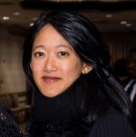 Headshot of Helen Yuen, an Asian woman with long dark hair wearing a dark colored shirt.