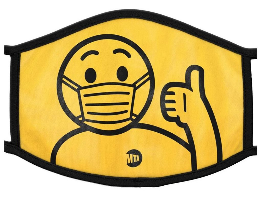 A yellow mask with black piping and a design of a human figure wearing an MTA t-shirt and flashing a thumbs up sign.