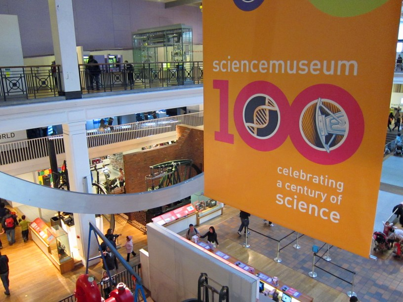 """Musuem interior with a banner reading """"Science Museum 100: celebrating a century of science"""""""