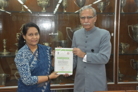 Prof. Samina Khan presenting a copy of the Handbook on Sexual Harassment to the  AMU VC Lt. Gen. Zameer Uddin Shah