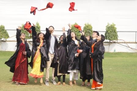 Students of JMI celebrating after receiving their degrees