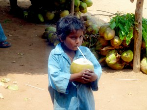 Although we had no extra cash to give him, this little kid was the recipient of my coworkers leftover coconut - and he was SO happy to have it and guzzled it down quickly!