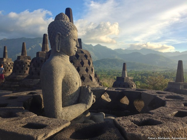 A lone Buddha overlooking Borobodur Temple in Java, Indonesia