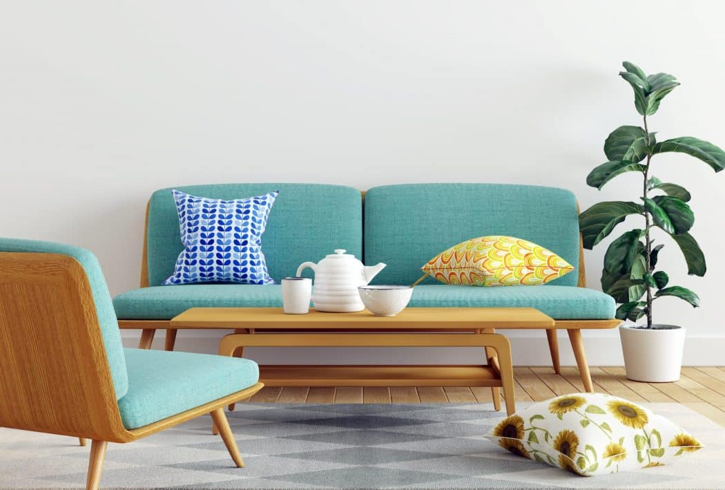 blue sofa with blue and yellow pillows - 5 rules in Interior Design that we are begging you to break!