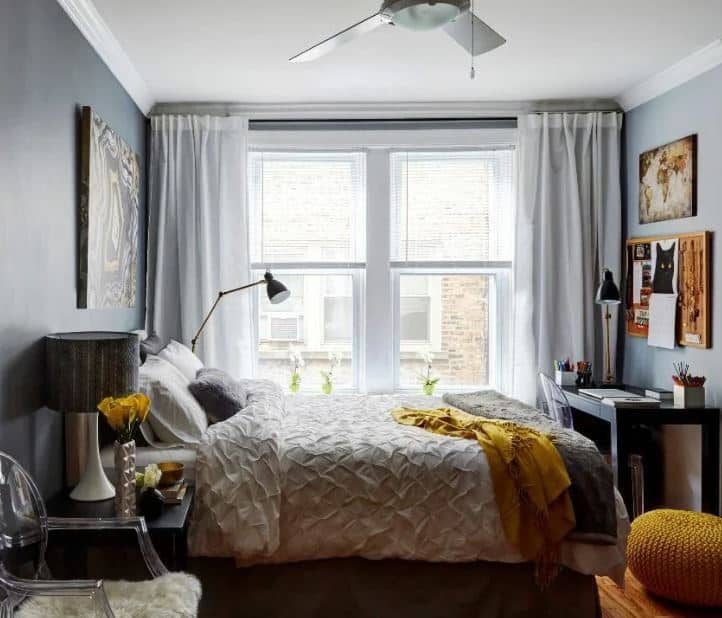 Double bedroom with gray and yellow blanket on the bed 1 - Layout ideas for Studio apartments