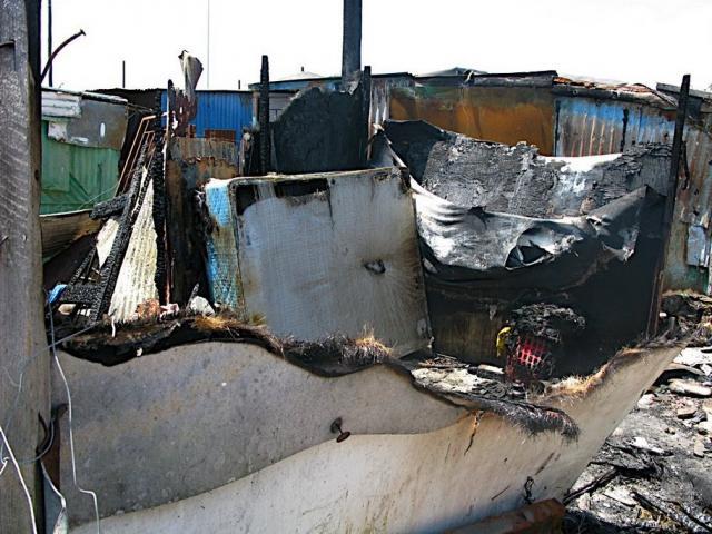 January 6, 2009. Fire destroys one shack in Khayelitsha, kills elderly couple. (2)