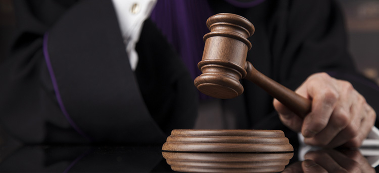 Lawyer is suspended after conviction for chest bumping a prosecutor