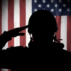 Soldier saluting the flag.