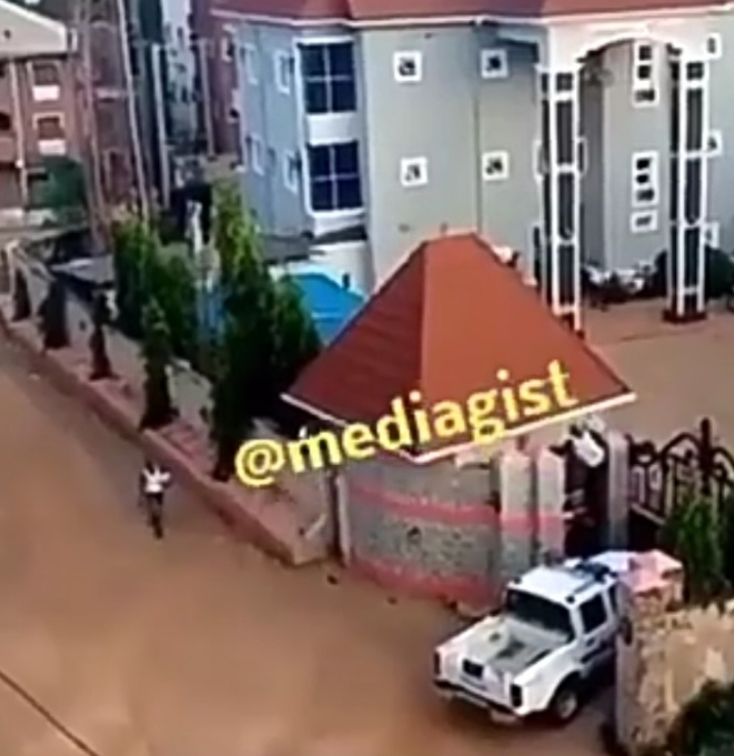 Watch the moment DPO jumped hotel fence after thugs stormed his police station (Video)