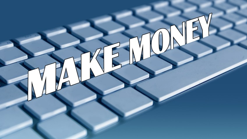 keyboard with sign that says make money