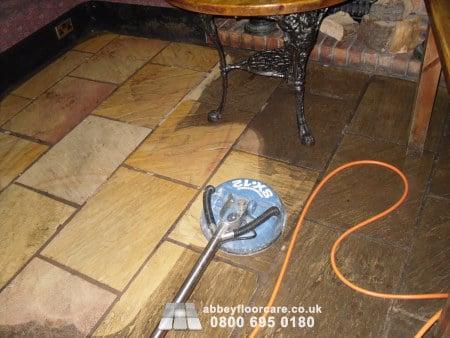 pressurised rinsing sandstone floor to remove emulsified soil