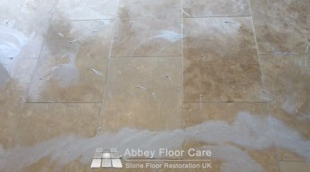 Applying heavy duty Travertine cleaner to dirty floor in Sutton Coldfield