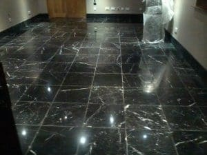 black marble floor polishing after