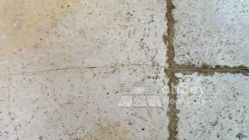dirty travertine floor
