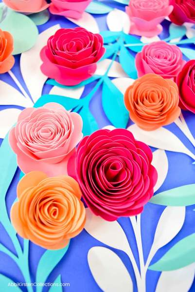 Small paper rosette flowers for shadow boxes.