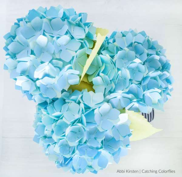 Create your own DIY paper hydrangea flowers with this easy and fun flower tutorial. Download the paper hydrangea templates to use with your Cricut machine or use the printable PDF files.