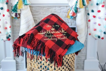 Easy DIY Christmas Gifts: Holiday blanket gift with vinyl. My Hallmark Christmas movie-watching blanket and Baby it's cold outside free SVG cut files.