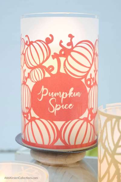 DIY Fall Table Decorations: How to make DIY vinyl and vellum Fall candle wraps with your Cricut.  FREE candle wrap SVG Files.