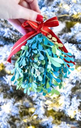 Paper Mistletoe Craft: How to Make Paper Mistletoe Kissing Balls. Download FREE mistletoe SVG cut files to use with your Cricut or Silhouette.