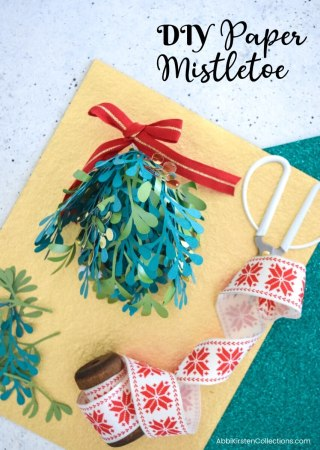 DIY Paper Mistletoe: How to Make Paper Mistletoe Kissing Balls. Download FREE mistletoe SVG cut files to use with your Cricut or Silhouette.