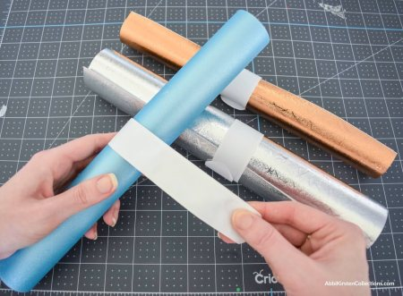 Use slap bracelets to keep vinyl rolls together.