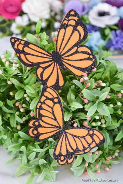 Learn how to make paper butterflies using cardstock and glitter vinyl. Create glitter butterflies that add eye-catching sparkle to any project!