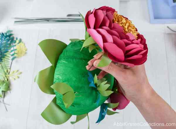 Adding paper flowers to your bouquet.