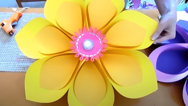 Giant paper flower tutorial for party backdrop decor.