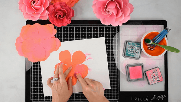 How to apply distress ink to paper flower petals.