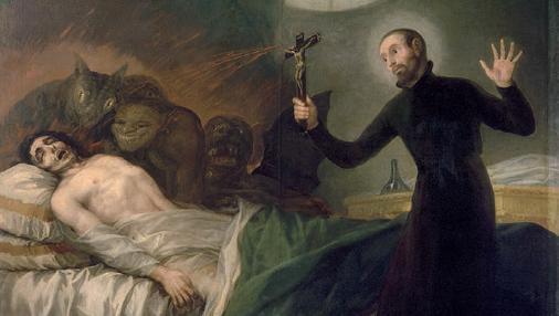 San Francisco de Borja realizando un exorcismo con un crucifijo.