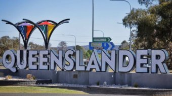 The Queenslander sign in the NSW-Queensland border town of Wallangarra in Queensland on October 8, 2020.