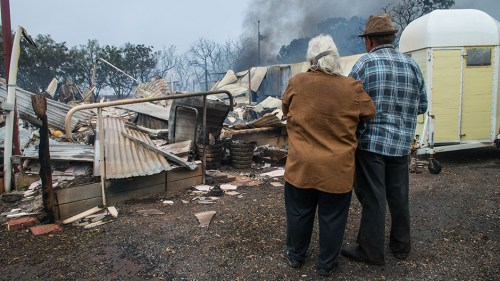 Property owners Jim and Lorraine inspect their destroyed house near Roseworthy in the mid-north of South Australia.