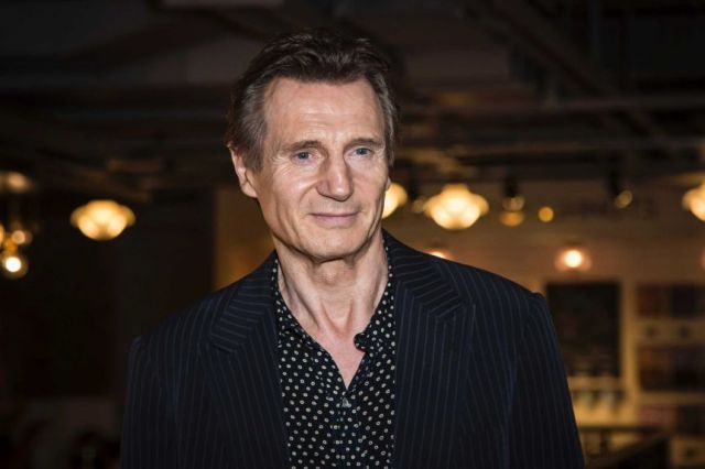 actor Liam Neeson poses for photographers